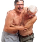 14589170-two-naked-seniors-laughing-and-fighting-for-fun-isolated-on-white-background